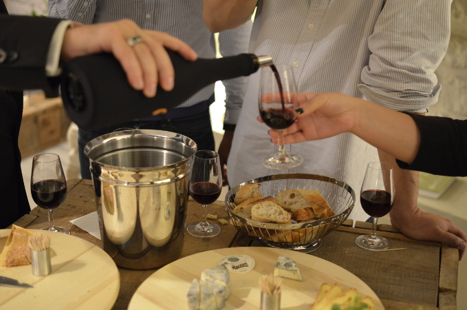 Wine & Cheese Pouring Red Wine